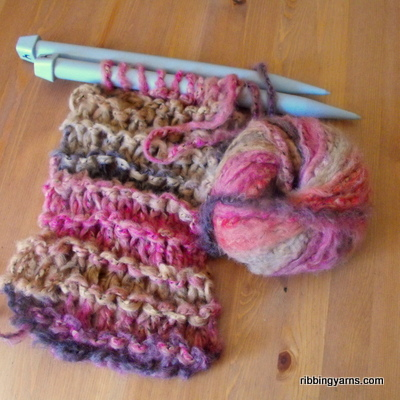 A ball of crazy sale yarn and big needles for a quick colourful scarf